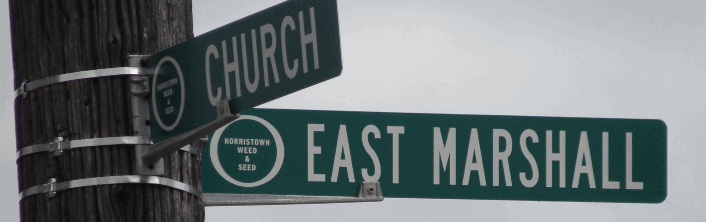 Street signs for the Norristown Hospitality Center