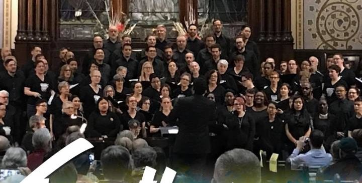 Photo of both choirs singing together at prior community events