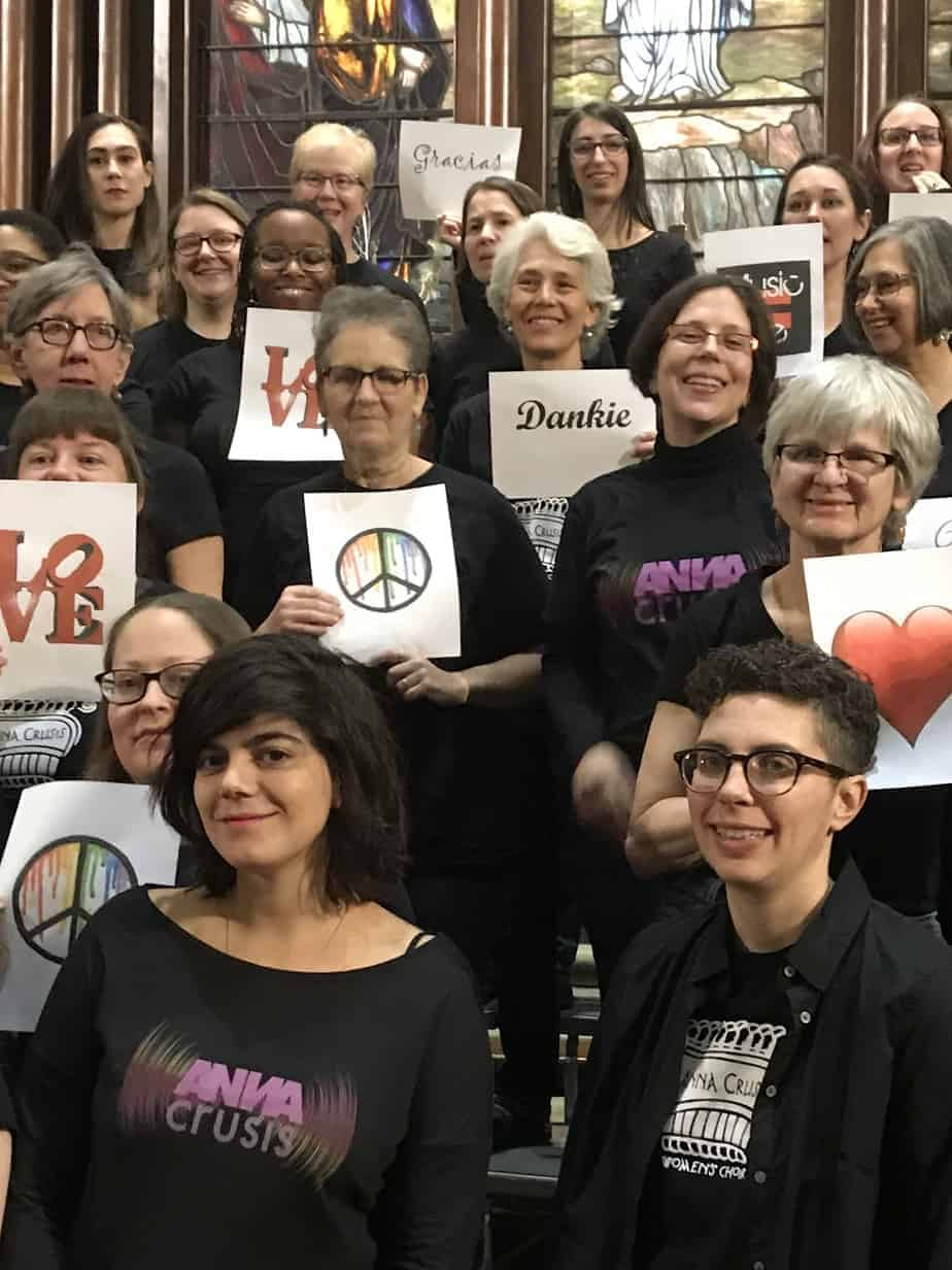 ANNA choir members holding peace and love signs